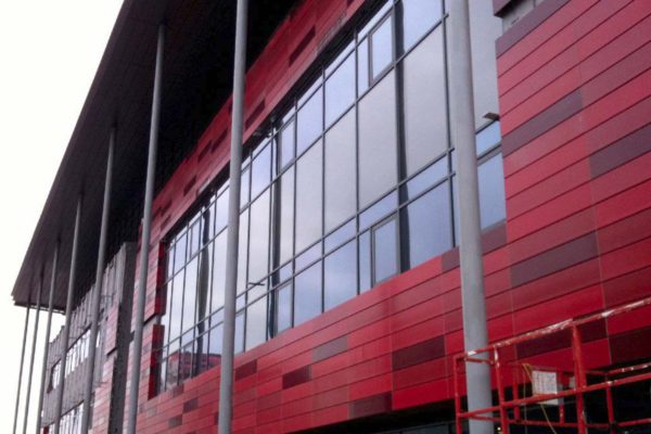 Close up of the red cladding on the Institute of Mental Health, Nottingham Uni