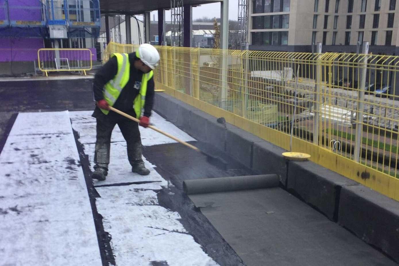 Hot melt roofing installation in progress