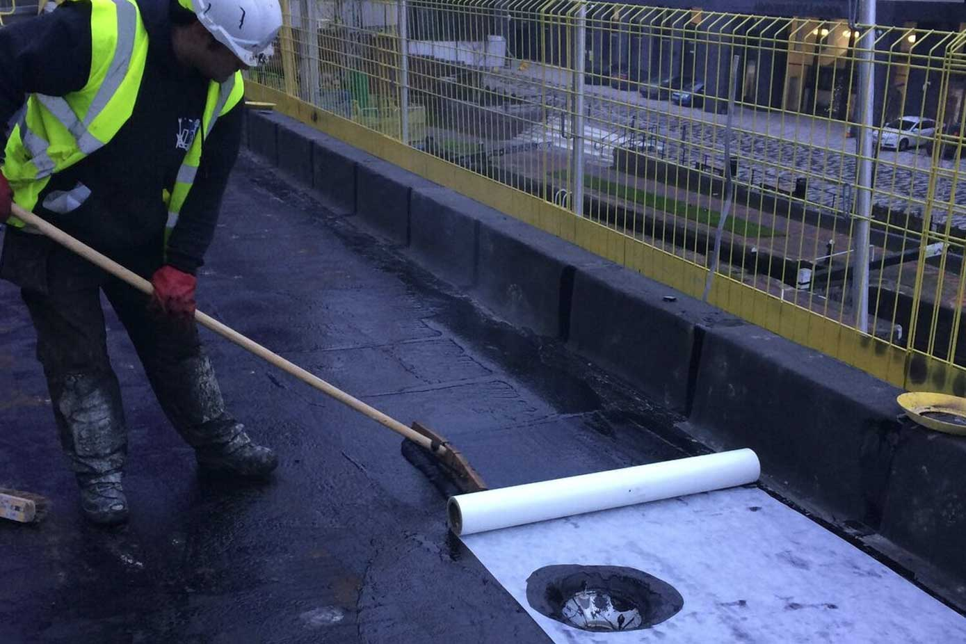 Hot melt membrane is layed on a flat roof