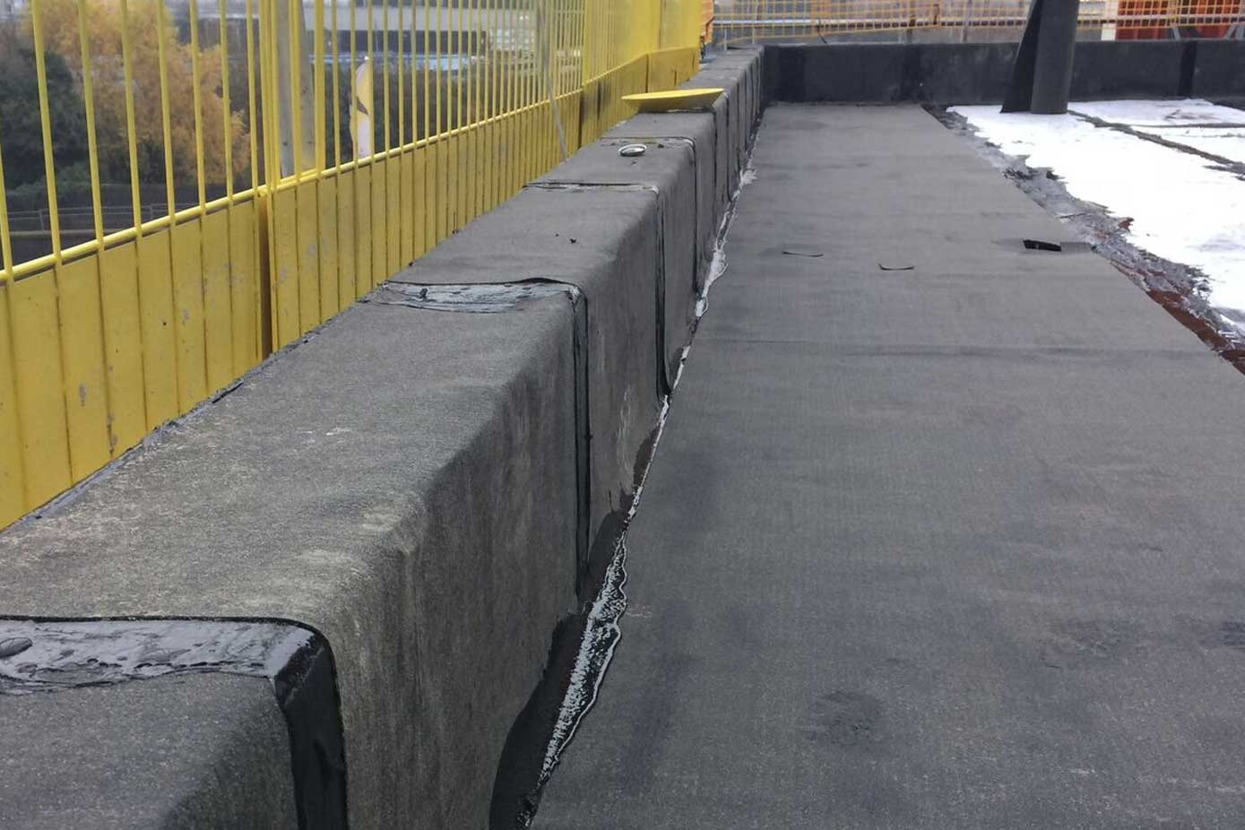 Hot melt roofing layer on a building